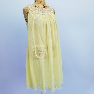 Pastel yellow nightgown with floral embroidery.